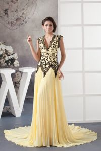 Unique Light Yellow V-neck Pleated Court Train Prom Dress with Black Lace