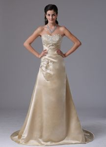 Sweetheart A-line Champagne Prom Attires with Brush Train with Beading