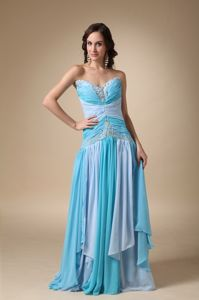 Pretty Lace-up Blue Ruched Brush Train Senior Prom Dresses with Appliques
